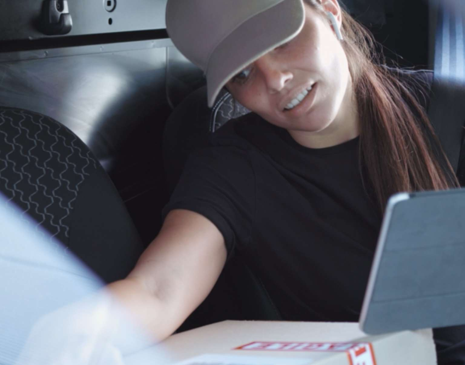 Woman checking packages on a mobile device